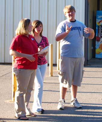 A mother and daughter get directions from a student member of CHAMPs. (Photo by Lana Clifton)