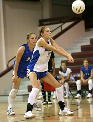 Morgan Crider returns serve in front of teammate Brianna Hays. (Photo by Rick Nation)
