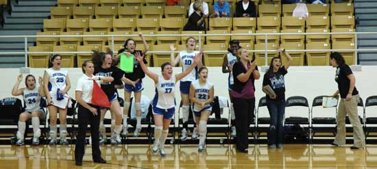 The Bryant bench celebrates the team winning a tight third set to take their State tourney opener over Rogers Heritage Tuesday. (Photo by Mark Hart)