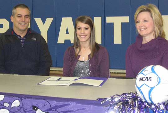 Haley Montgomery, flanked by her parents, signed a letter of intent Wednesday to attend UCA under a soccer scholarship.