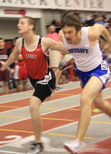Stanley Oxner and a Cabot runner leaning at the finish of the 400 meter dash. (Photo courtesy of Carla Thomas)