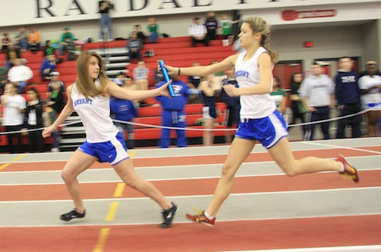 Andrea Savage hands off the baton to Lauren Stiles in the 4 x 400 relay. (Photo courtesy of Carla Thomas)