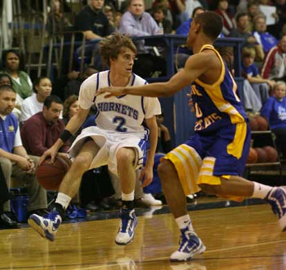 Brandon Parish (2) looks upcourt while being guarded by North Little Rock's Brandon Tyler. (Photo by Rick Nation)
