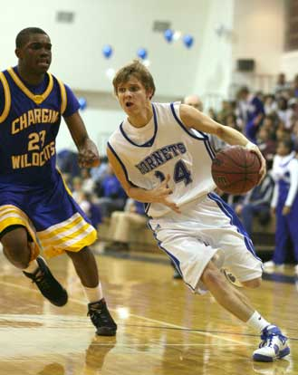 Bryant's Connor Rayburn drives around North Little Rock's Chris Campbell. (Photo by Rick Nation)