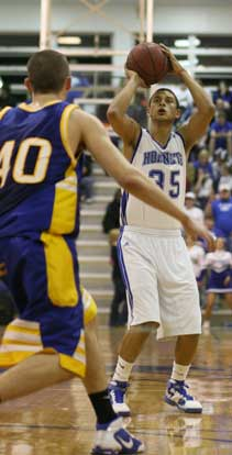 Dontay Renuard launches a 3. (Photo by Rick Nation)