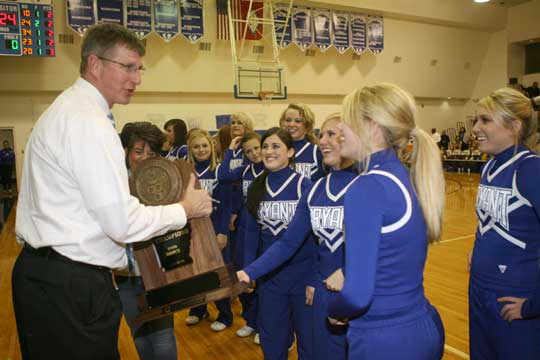 Bryant High School principal Randy Rutherford accepted several of the trophies earned by those honored on Tuesday night including the State championship and national awards earned by the Bryant varsity dance team. (Photo by Rick Nation)