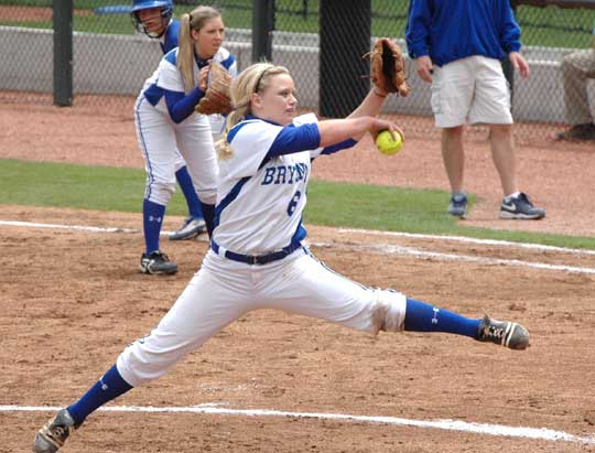 Peyton Jenkins delivers a pitch as Kayla Sory sets up defensively at first base during a game last season. (Photo by Mark Hart)