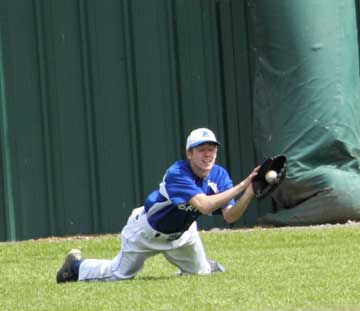 Caleb Garrett makes a diving catch in right for the Hornets. (Photo by Phil Pickett)