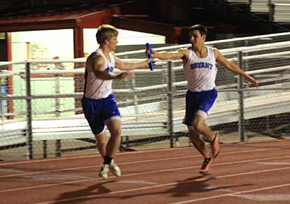 Dylan Blasi hands the baton to Tyler Freshour during 1600 meter relay at Cabot Tuesday. (Photo by Carla Thomas)