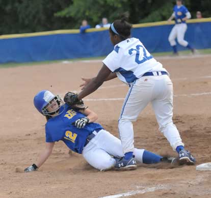 Bryant's Shanika Johnson tags out a North Little Rock player on a play at third. (Photo by Kevin Nagle)