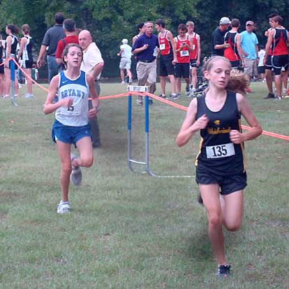 Caroline Cato, left, was the top finisher for the Bryant junior girls.