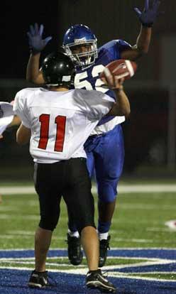 Bryant's L.J. Allen pressures Russellville quarterback Cody Jones. (Photo by Rick Nation)