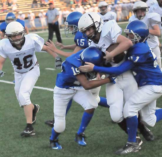 Trey Harris (19) and Ethan Henderson (51) make a tackle. (Photo by Kevin Nagle)