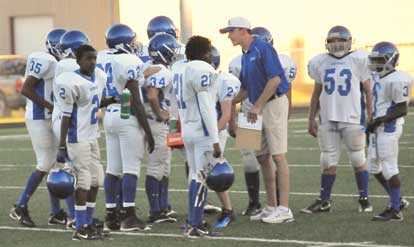 Bryant White coach Brad Smotherman huddles with his defense. (Photo by Kevin Nagle)