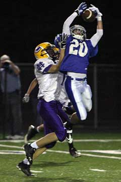 Drew Tipton (20) leaps for an interception. (Photo by Rick Nation)