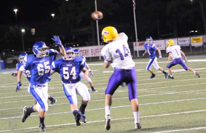 Tommy Wedge (65) and Drew Allen (54) put pressure on the quarterback. (Photo by Kevin Nagle)