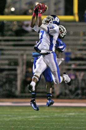 Aaron Bell (7) goes high for one of his two interceptions. (Photo by Rick Nation)