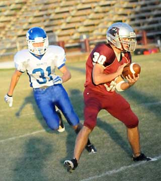 Bryant's Stoney Stevens (31) closes in on Benton's Shaun Carey. (Photo by Kevin Nagle)