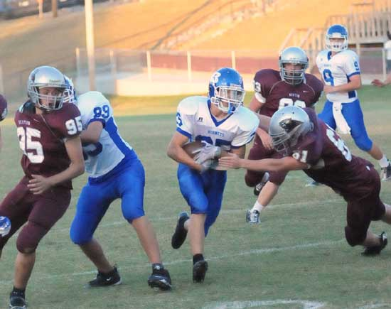 Sophomore tight end Kaleb Squires (89) blocks Benton's Trey Lester (95) as Jeffery Hodge (61) tries to get a hold on Bryant's running back. (Photo by Kevin Nagle)