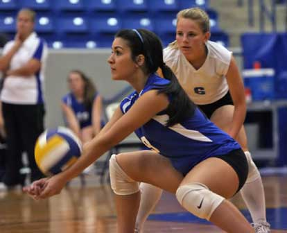 Rochelle Aguilar digs up a serve in front of teammate Lauren Reed. (Photo by Rick Nation)