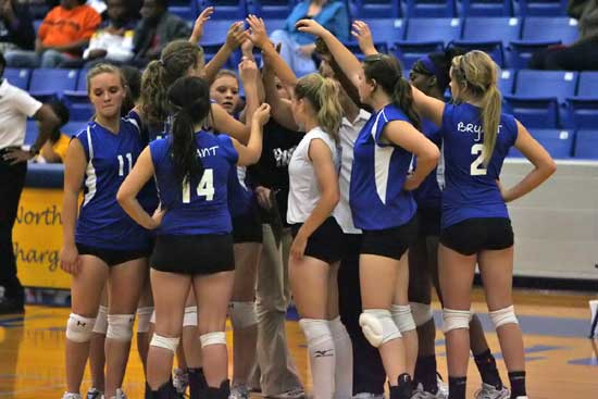 The Lady Hornets huddle around their coaches during Tuesday's match at North Little Rock. (Photo by Rick Nation)