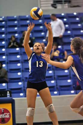 Bryant senior Taylor West (13) sets for teammate Alyssa Anderson. (Photo by Rick Nation)