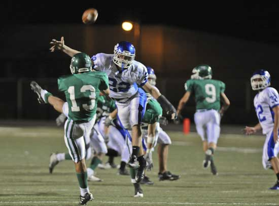 Jacob Powell blocks Houston Ray's punt. (Photo by Ron Boyd)