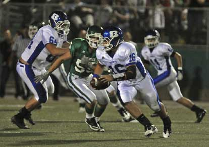 Hayden Lessenberry (16) rolls out to the left, picking up a block from tackle Seth Alkire (64). (Photo by Ron Boyd)