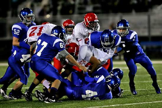 The Bryant defense including Devin Kelly (67), Matt Shiew (42), Ty Harris (1) and Austin Trusty (52) pile up Cabot North running back Alex Rodriguez during Thursday's game. (Photo by Rick Nation)