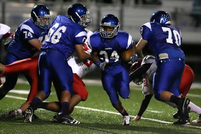 Bryant linemen Chad Adams (74), Caleb Chaffin (66) and Caleb McElyea (70) make way for Brushawn Hunter (34). (Photo by Rick Nation)