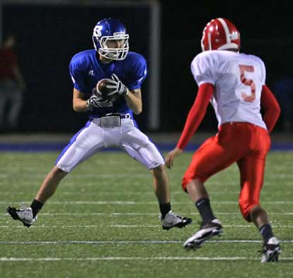 Sawyer Nichols (1) makes a move to get past Cabot's Jordan Burke. (Photo by Rick Nation)