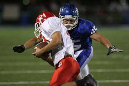 Michael Smith descends on Cabot running back Zach Launius. (Photo by Rick Nation)