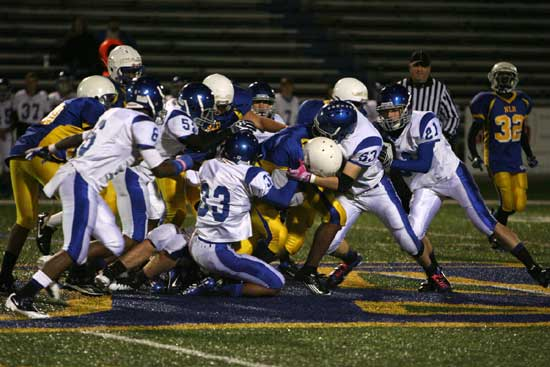 Ryan Hall (53), Brendan Young (33), Ben Bruick (21), Austin Trusty (52) and K.J. Hill (6) swarm around a North Little Rock ball carrier. (Photo by Rick Nation)