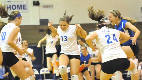 Alyssa Anderson (10), Taylor West (13), Lauren Reed and Brooke Howell (24) celebrate a point. (Photo by Kevin Nagle)