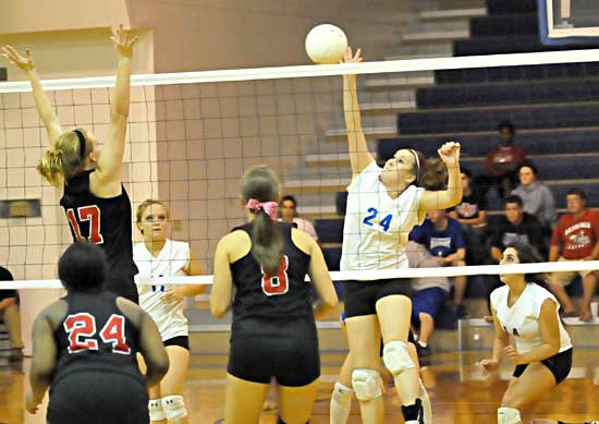 Brooke Howell (24) spikes the ball. (Photo by Kevin Nagle)