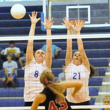 Erica Smith (8) and Courtney Davidson (21) go up for a block. (Photo by Kevin Nagle)