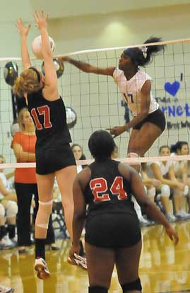 Brianna White skies on an attack. (Photo by Kevin Nagle)