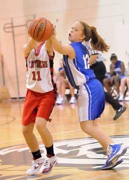 Kara Moser (12) deflects a pass. (Photo by Kevin Nagle)