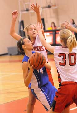 Kailey Nagle looks for room to shoot. (Photo by Kevin Nagle)