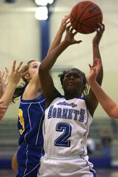 Jayla Anderson (2) tries to get a shot away. (Photo by Rick Nation)