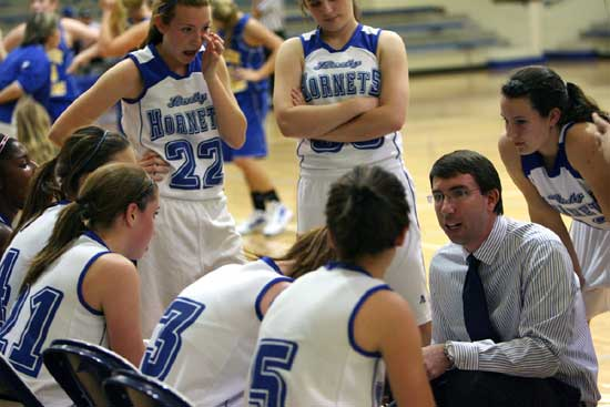 Bryant freshman coach Nathan Castaldi instructs his team during a timeout. (Photo by Rick Nation)