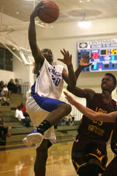 J.C. Newborn goes up for a shot over Lake Hamilton's Jason Burks. (Photo by Rick Nation)