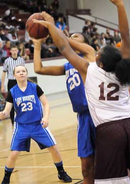 Faith Brown (20) tries to get a shot away in front of teammate Skylar Davis (23). (Photo by Kevin Nagle)