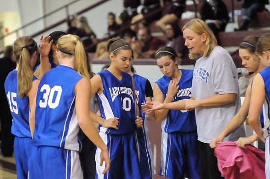 Bryant White coach DeAnna Ward instructs her team during a timeout. (Photo by Kevin Nagle)