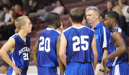 Bryant coach Jim Pennington meets with his team during a break in the action Monday. (Photo by Kevin Nagle)