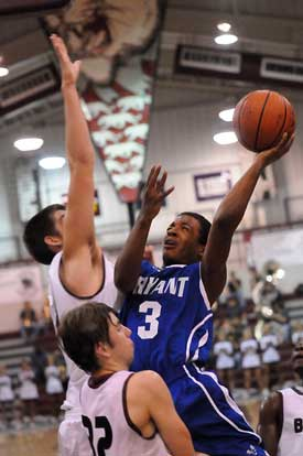 Bryant's C.J. Rainey tries to get a shot up over Benton's Graham Gardner. (Photo by Kevin Nagle)