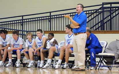 Bryant White coach Heath Long exhorts his team. (Photo by Kevin Nagle)