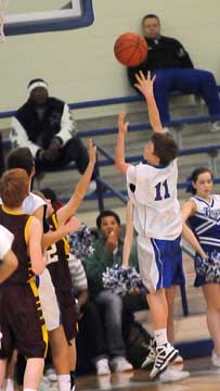 Dylan Hurt (11) sends up a shot. (Photo by Kevin Nagle)