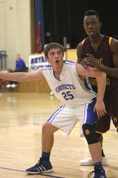 Bryant's Ryan Hall (25) tries to post up on an inbounds play against Lake Hamilton's Jason Burks. (Photo by Rick Nation)