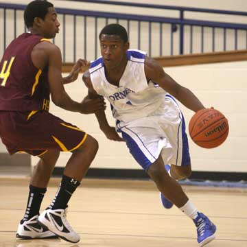 Bryant's K.J. Hill, right, drives around Lake Hamilton's Donnell West (4). (Photo by Rick Nation)